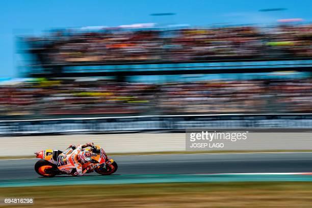 TOPSHOT Secondplaced Repsol Honda Team's Spanish rider Marc Marquez competes during the MotoGP race of the Moto Grand Prix de Catalunya at the...
