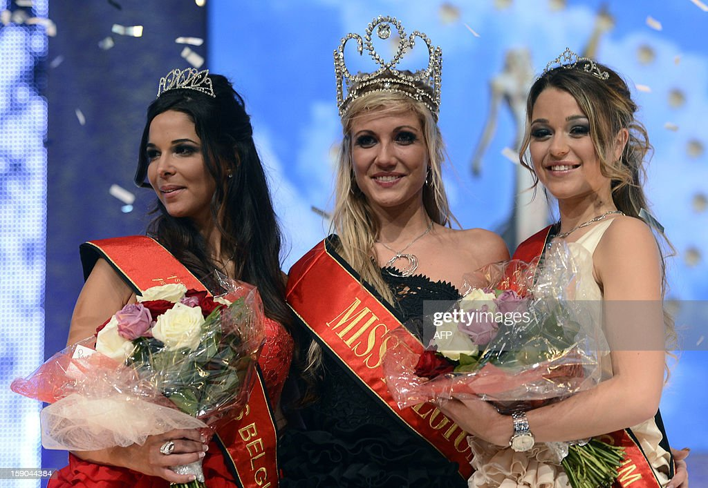 Second-placed Sherine Dandoy, first-placed Noemie Happart and third-placed Melissa Vingerhoed pose at the end of the at the Miss Belgium 2013 beauty contest in the Knokke casino, on January 6, 2013. AFP PHOTO/BELGA/ DIRK WAEM -Belgium Out-