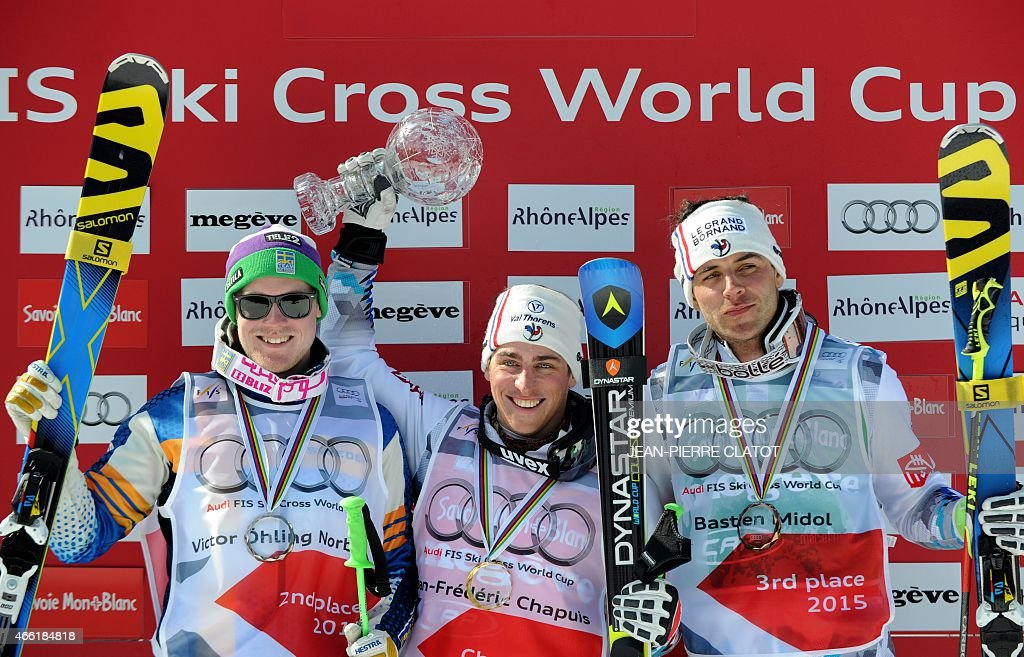 Second-placed Victor Oehling Norberg of Sweden, winner Jean-Frederic Chapuis of France and third-placed Bastien Midol of France celebrate on the podium after the men's FIS Skicross Final World Cup 2015 Crystal Globe event on March 14, 2015 in Megeve, French Alps.