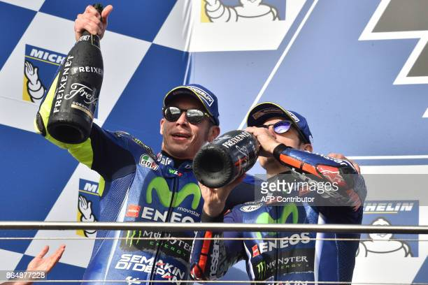 Secondplaced Yamaha rider Valentino Rossi of Italy and thirdplaced Yamaha rider Maverick Vinales of Spain celebrate at the end of the Australian...