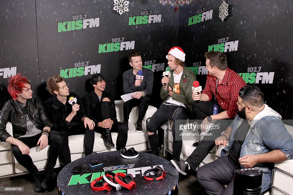 5 Seconds of Summer members (from L) Michael Clifford, Luke Hemmings, Calum Hood and Ashton Irwin (5th L, wearing hat) and radio personalities JoJo Wright (4th L), Jesse Lozano (2nd R) and Chuey Martinez (R) attend KIIS FM's Jingle Ball 2014 powered by LINE at Staples Center on December 5, 2014 in Los Angeles, California.