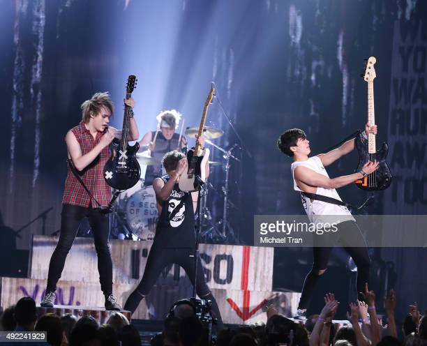 Seconds of Summer perform onstage during the 2014 Billboard Music Awards held at MGM Grand Garden Arena on May 18 2014 in Las Vegas Nevada
