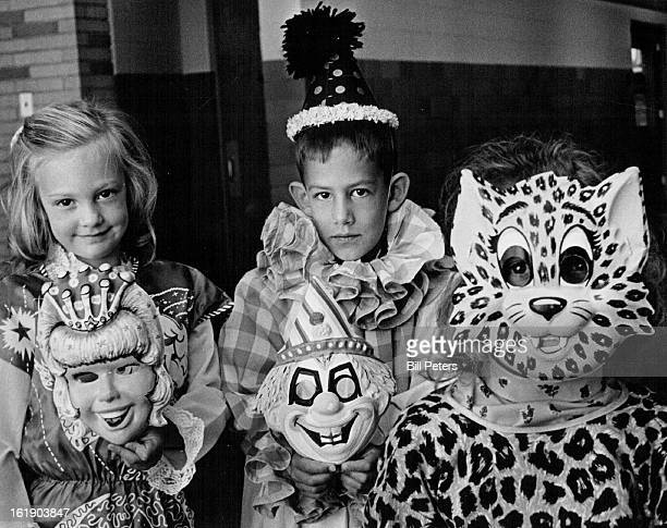 OCT 7 1969 OCT 10 1969 OCT 15 1969 Secrest School Plans Carnival Trying on costumes that will be for sale at the Secrest Elementary School carnival 6...