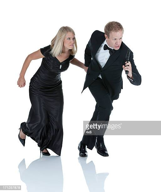 Secret agent running with a woman