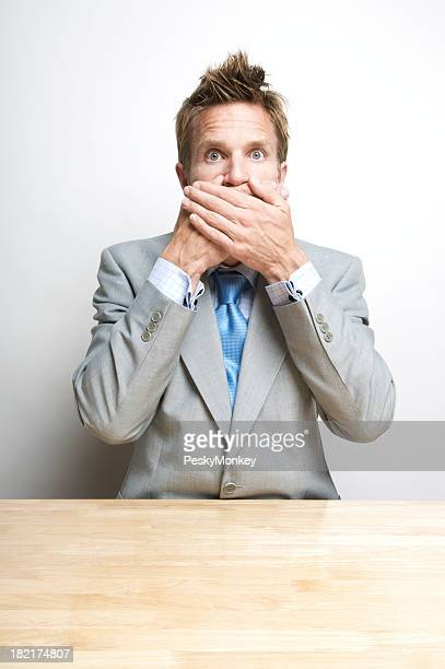 Secret Businessman Office Worker Covering Mouth Speaks No Evil Desk