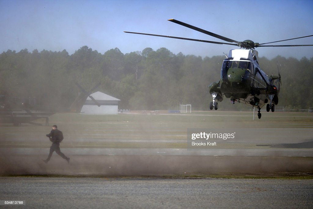 A Secret Service agent runs as Marine One helicopter with President George W Bush aboard makes its landing in Statesboro Bush is traveling to Georgia...