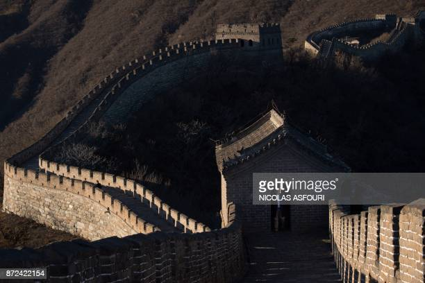 US secret service agent secures a section of the Great Wall of China closed off to tourists ahead of the arrival of US First Lady Melania Trump on...