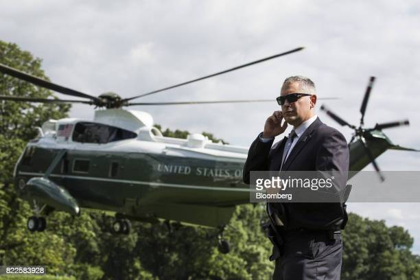 A US Secret Service Agent stands as Marine One with US President Donald Trump and First Lady Melania Trump onboard departs the South Lawn of the...
