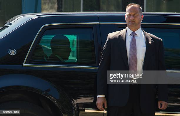 A Secret Service agent stands by the limousine of US President Barack Obama as he arrives at Walter Reed National Military Medical Center in Bethesda...