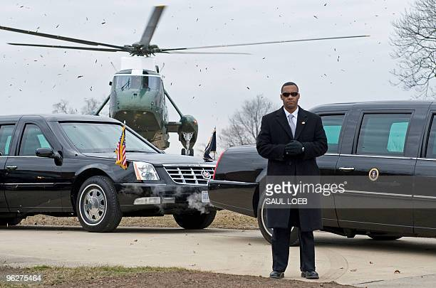 Secret Service agent stands by US President Barack Obama's limousine as Obama arrives on Marine One at Fort McHenry in Baltimore Maryland January 29...