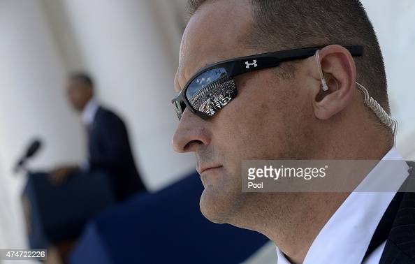 Secret Service agent stands guard as US President Barack speaks during a Memorial Day ceremony at Arlington National Cemetery May 25 2015 in...