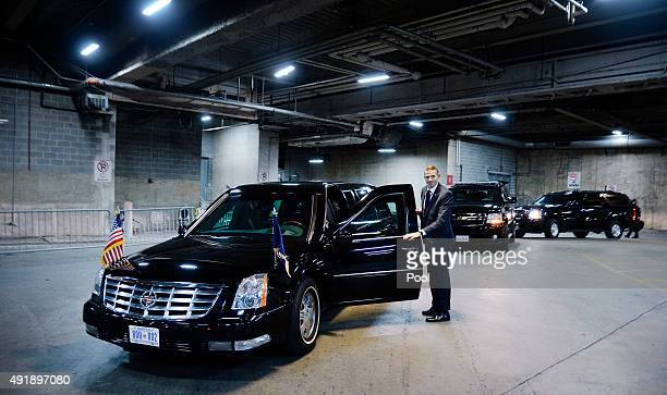 Secret Service Agent stands next to US President Barack Obama's car knicknamed 'the beast' in underground parking at the Congressional Hispanic...