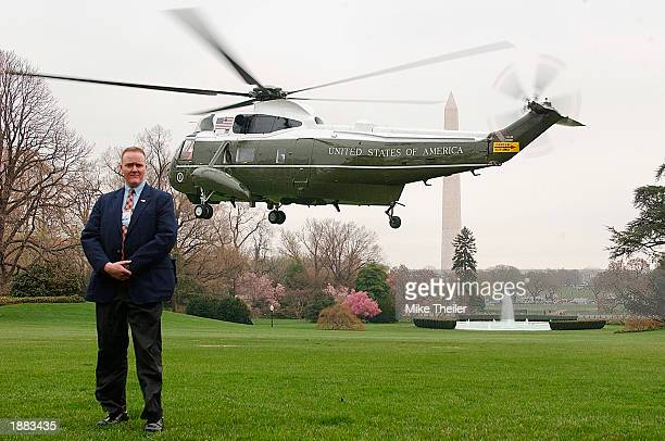 Secret Service agent stands on the South Lawn as Marine One lifts off with US President George W Bush and first lady Laura Bush as they depart for...