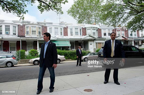 Secret service agents and a campaign aide monitor the street where former Massachusetts Gov Mitt Romney a candidate for the Republican presidential...