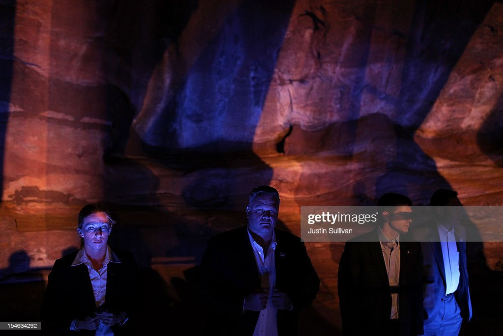 U.S. Secret Service agents look on during a canmpaign rally for Republican presidential candidate, former Massachusetts Gov. Mitt Romney at the Red Rocks Amphitheatre on October 23, 2012 in Morrison, Colorado. A day after the final Presidential debate, Mitt Romney is campaigning in Nevada and Colorado.