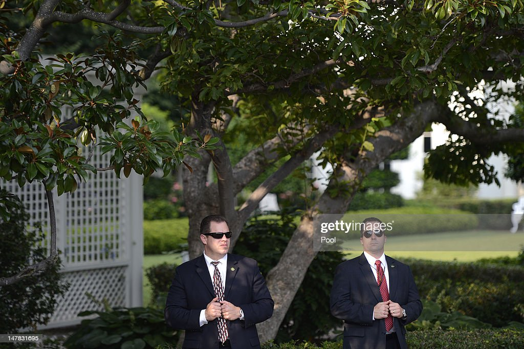 U.S. Secret Service agents on post as U.S. President Barack Obama delivers remarks to an Independence Day picinic on the South Lawn of the White House on July 4, 2012 in Washington, D.C. On this Independence Day President Obama is hosting a 4th of July celebration picnic on the South Lawn for White House staff and US service members.