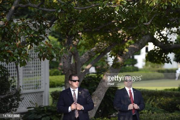 US Secret Service agents on post as US President Barack Obama delivers remarks to an Independence Day picinic on the South Lawn of the White House on...