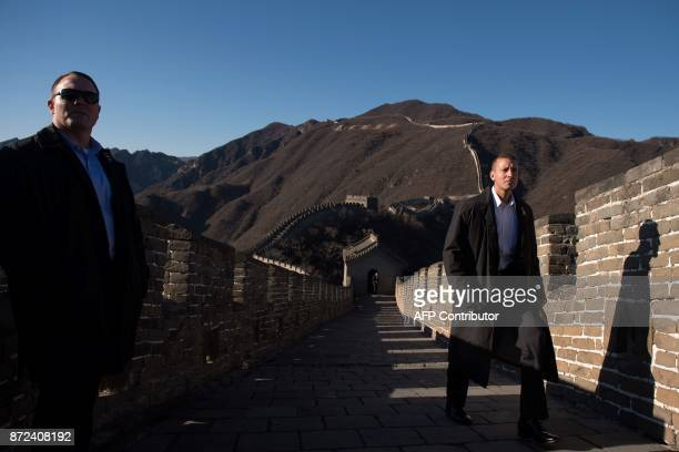 US Secret Service agents secure an area ahead of the arrival of US First Lady Melania Trump on the Great Wall of China on the outskirts of Beijing on...
