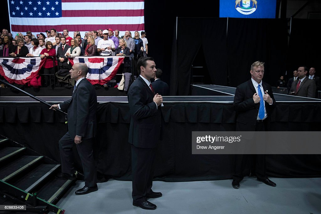 U.S. Secret Service agents stand guard as President-elect Donald Trump speaks at the DeltaPlex Arena, December 9, 2016 in Grand Rapids, Michigan. President-elect Donald Trump is continuing his victory tour across the country.