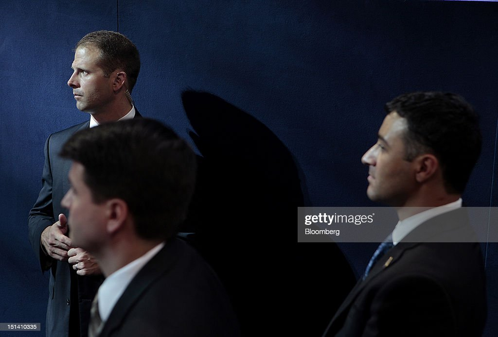Secret service agents stand while U.S. President Barack Obama, unseen, speaks during day three of the Democratic National Convention (DNC) in Charlotte, North Carolina, U.S., on Thursday, Sept. 6, 2012. President Barack Obama's prime-time nomination acceptance speech tonight at the DNC is aimed at convincing voters that a slow economic recovery will accelerate if they give him a second term. Photographer: Andrew Harrer/Bloomberg via Getty Images