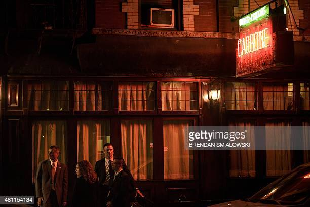 Secret Service and others stand outside the Carbone restaurant while US President Barack Obama has dinner July 17 2015 in New York New York AFP...