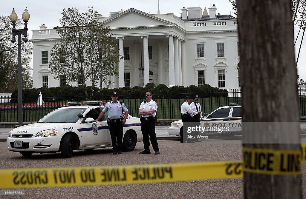 U.S. Secret Service and U.S. Park Police officers stand guard on Pennsylvania Avenue in front of the White House April 15, 2013 in Washington, DC. Security around the White House was tightened after two people are confirmed dead and at least 28 injured after at least two explosions went off near the finish line of the Boston Marathon.