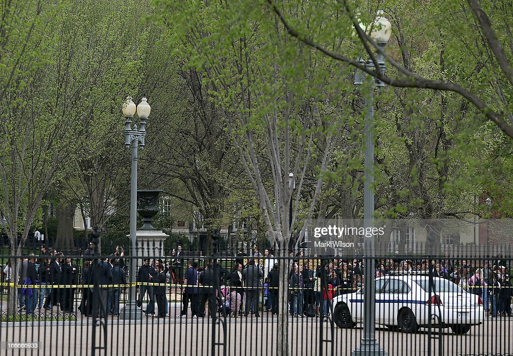 U.S. Secret Service cordon off Pennsylvania Avenue in front if the White House as a precautionary measure April 15, 2013 in Washington, DC. Two people are confirmed dead and at least 23 injured after two explosions went off near the finish line of the Boston Marathon.