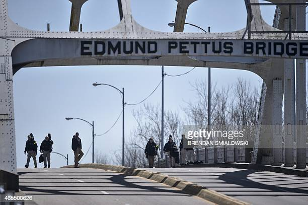 US Secret Service counter snipers cross the Edmund Pettus Bridge on March 7 2015 in Selma Alabama US President Barack Obama and the first family will...