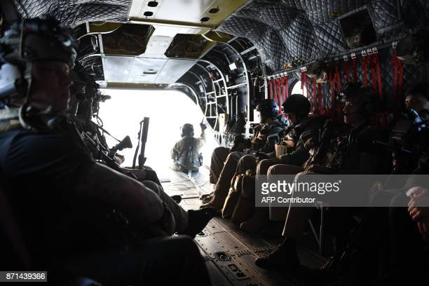 Secret Service counterassault team members accompanying US President Donald Trump in another helicopter ride in the back of a helicopter as they...
