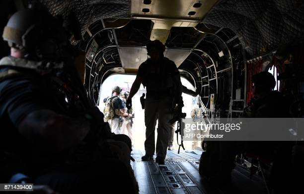 Secret Service counterassault team members accompanying US President Donald Trump in another helicopter board a helicopter as they attempt to fly to...
