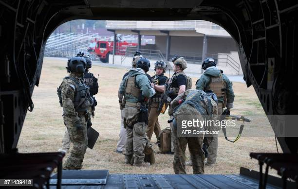 Secret Service counterassault team members accompanying US President Donald Trump in another helicopter prepare to board a helicopter as they attempt...