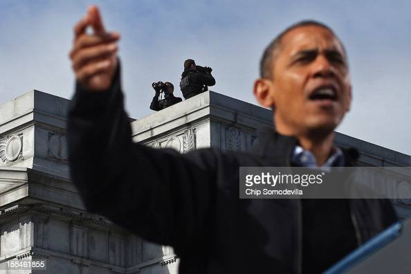 Secret Service countersniper team keeps an eye on State Capitol Square and the surrounding area as US President Barack Obama addresses a campaign...