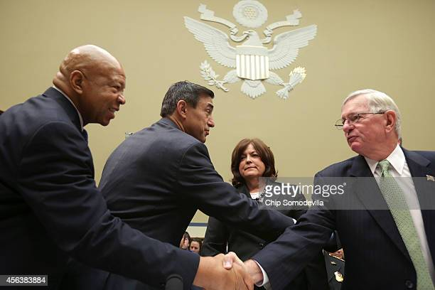Secret Service Director Julia Pierson watches as Commissioner for US Customs and Border Protection W Ralph Basham greets chairman of the House...