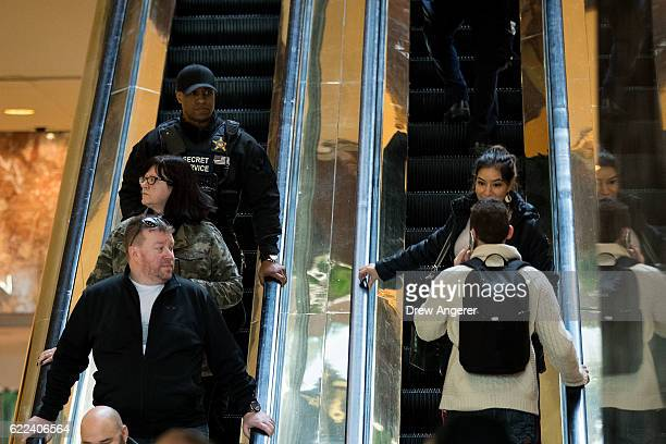 S Secret Service member rides an escalator inside Trump Tower November 11 2016 in New York City On Friday morning Trump tweeted that he 'has a busy...