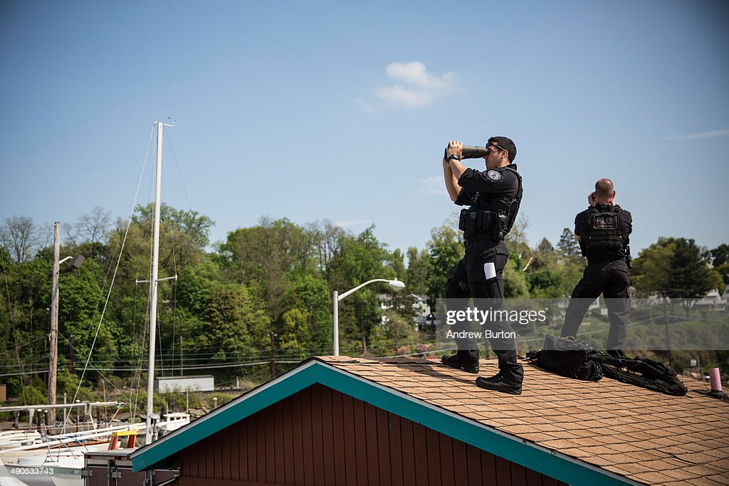 U.S. Secret Service members survey the area while waiting for U.S. President <a gi-track='captionPersonalityLinkClicked' href=/galleries/search?phrase=Barack+Obama&family=editorial&specificpeople=203260 ng-click='$event.stopPropagation()'>Barack Obama</a> to arrive at the Washington Irving Boat Club on May 14, 2014 in Tarrytown, New York. Tomorrow President Obama will attend the opening of the National September 11 Memorial and Museum.