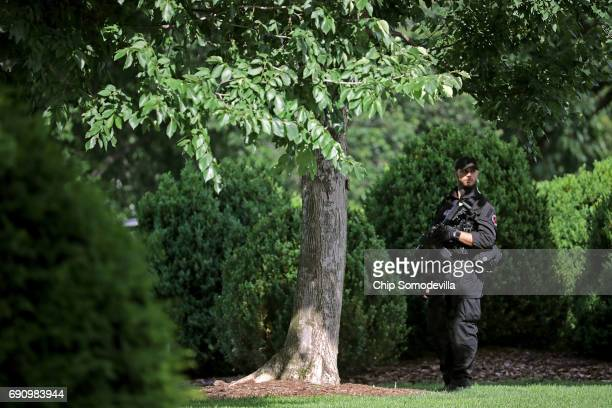 Secret Service officer stands guard on the North Lawn of the White House following a temporary lock down May 31 2017 in Washington DC The reason for...