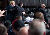 Secret Service swarms around Republican Presidential candidate Donald Trump after a bottle was thrown on stage at a Campaign Rally on March 12 2016...