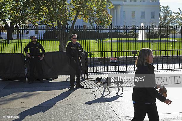 S Secret Service Uniform Division K9 officer uses a dog to screen people walking past the north side of the White House November 16 2015 in...