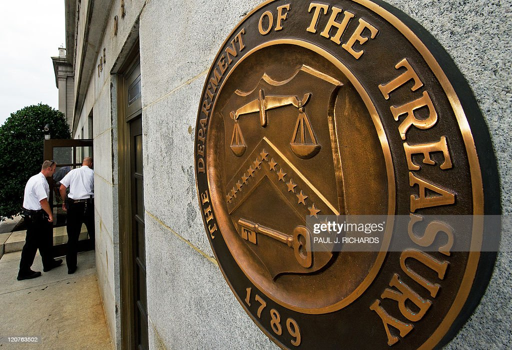 US Secret Service Uniform Division officers walk in the door near the seal on the US Treasury building August 9 in Washington DC AFP Photo/Paul J...