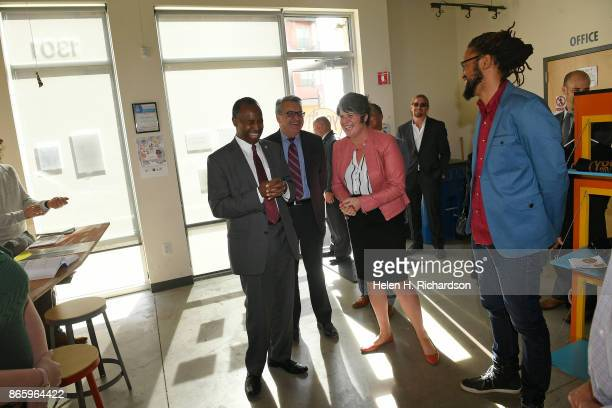 Secretary Ben Carson left as part of a tour of the Mariposa development the Denver Housing Authority's crown jewel for mixedincome living and urban...