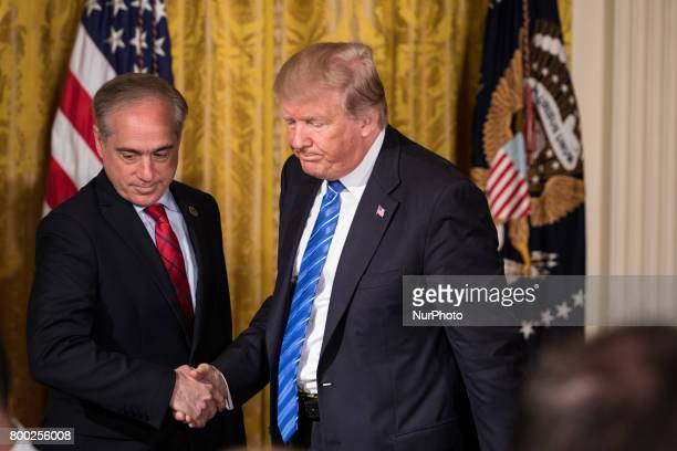 VA Secretary David Shulkin and President Donald Trump shake hands before signing the Department of Veterans Affairs Accountability and Whistleblower...