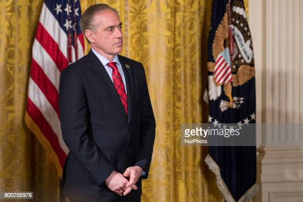 VA secretary David Shulkin listens as President Donald Trump speaks before signing the Department of Veterans Affairs Accountability and...