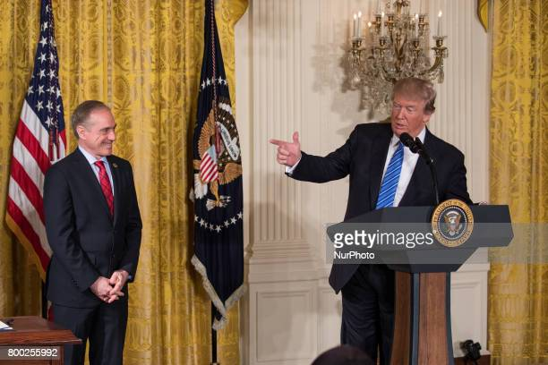 VA Secretary David Shulkin stands by as President Donald Trump speaks before signing the Department of Veterans Affairs Accountability and...