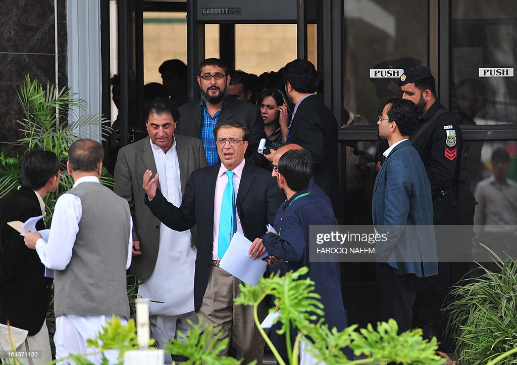 Secretary Election Commission of Pakistan Ishtiaque Ahmed (C) comes out for media briefing after the meeting to discuss the caretaker Prime Minister in Islamabad on March 23, 2013. Ahmed said the commission had two days to decide a name for the caretaker prime minister. AFP PHOTO/ Farooq NAEEM
