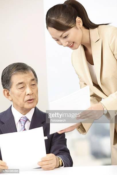 Secretary explaining about a report
