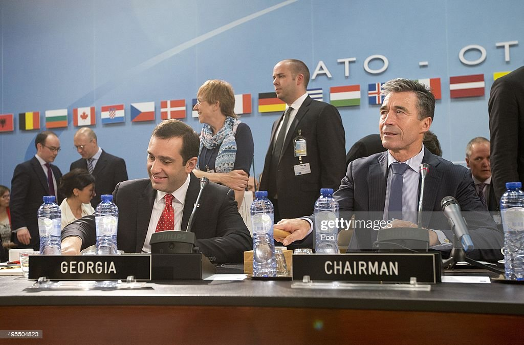 Secretary General Anders Fogh (R) and Georgian Defense Minister Irakli Alasania take their seat at a meeting of the NATO-Georgia Commission at NATO headquarters on June 4, 2014 in Brussels, Belgium. NATO defense ministers met with their Georgian counterparts on Wednesday to discuss security and cooperation issues.