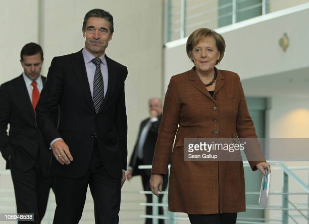 Secretary General Anders Fogh Rasmussen and German Chancellor Angela Merkel arrive to speak to the media following talks at the Chancellery on...