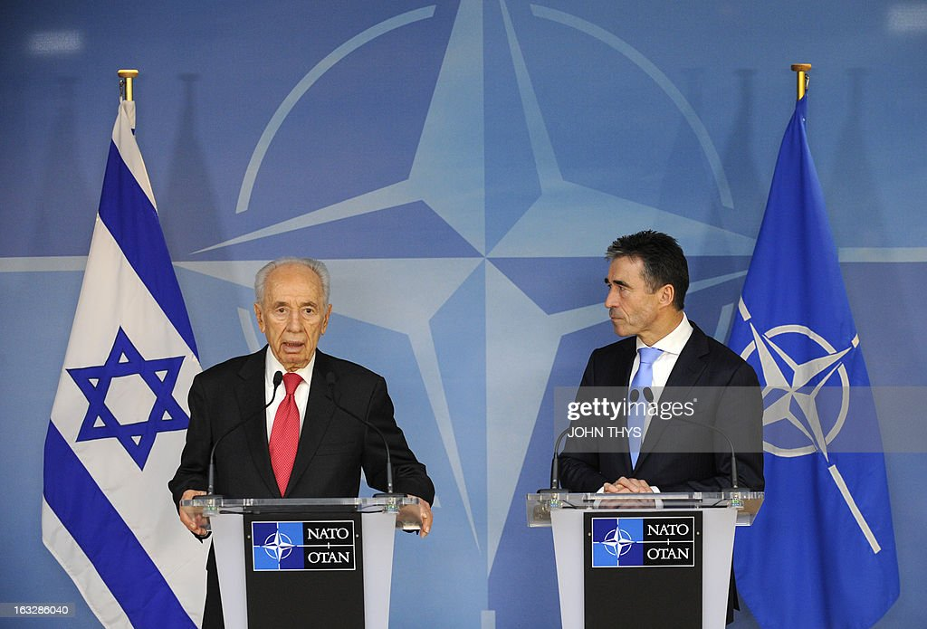 Secretary General Anders Fogh Rasmussen (R) and President of Israel Shimon Peres (L) give a joint press after their bilateral meeting at the Nato Headquarters in Brussels on March 7, 2013.