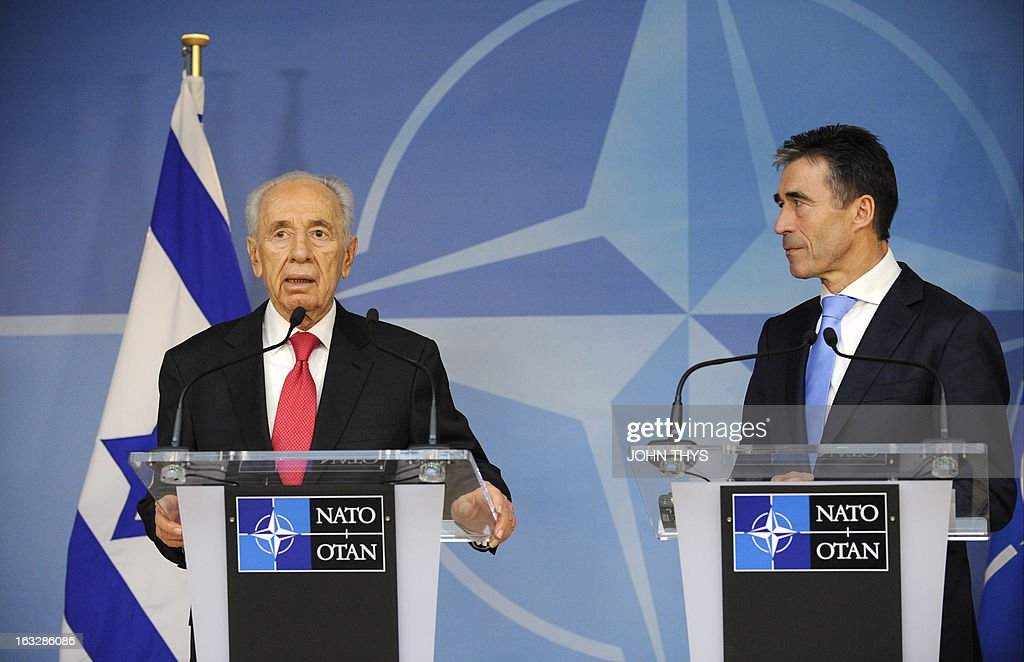 Secretary General Anders Fogh Rasmussen (R) and President of Israel Shimon Peres (L) give a joint press after their bilateral meeting at the Nato Headquarters in Brussels on March 07, 2013.