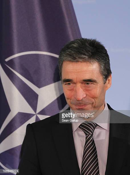 Secretary General Anders Fogh Rasmussen arrives with German Foreign Minister Guido Westerwelle for a brief photo op following talks at the Federal...
